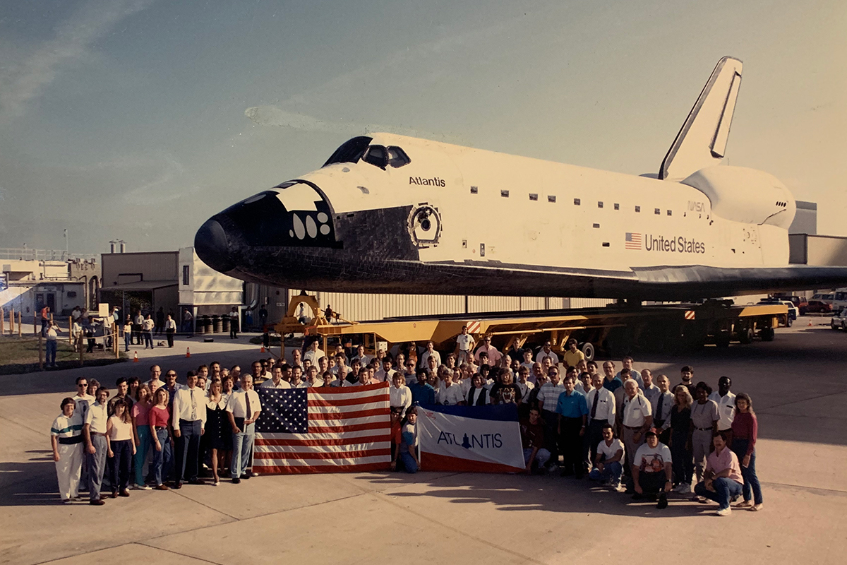 space shuttle Atlantis with NASA workers