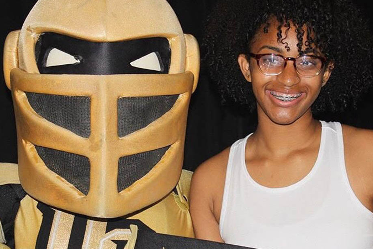 Knightro with Amiyah Murphy-Allison.
