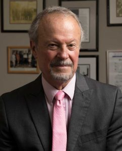 Richard Lapchick in suit and tie