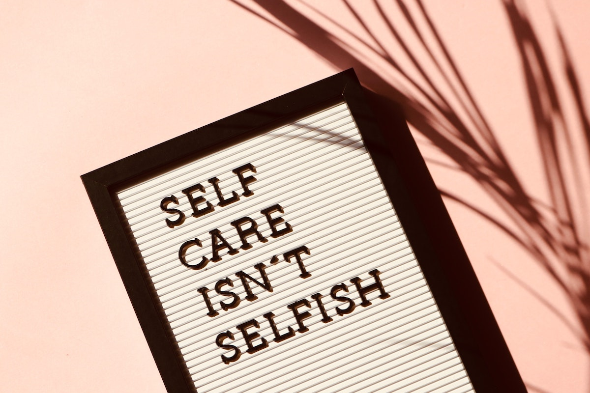 sign: self care isn't selfish