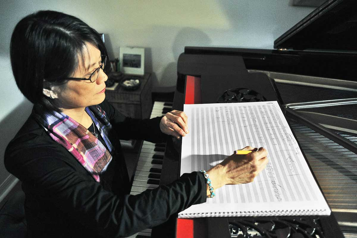 Stella Sung sits at desk to compose