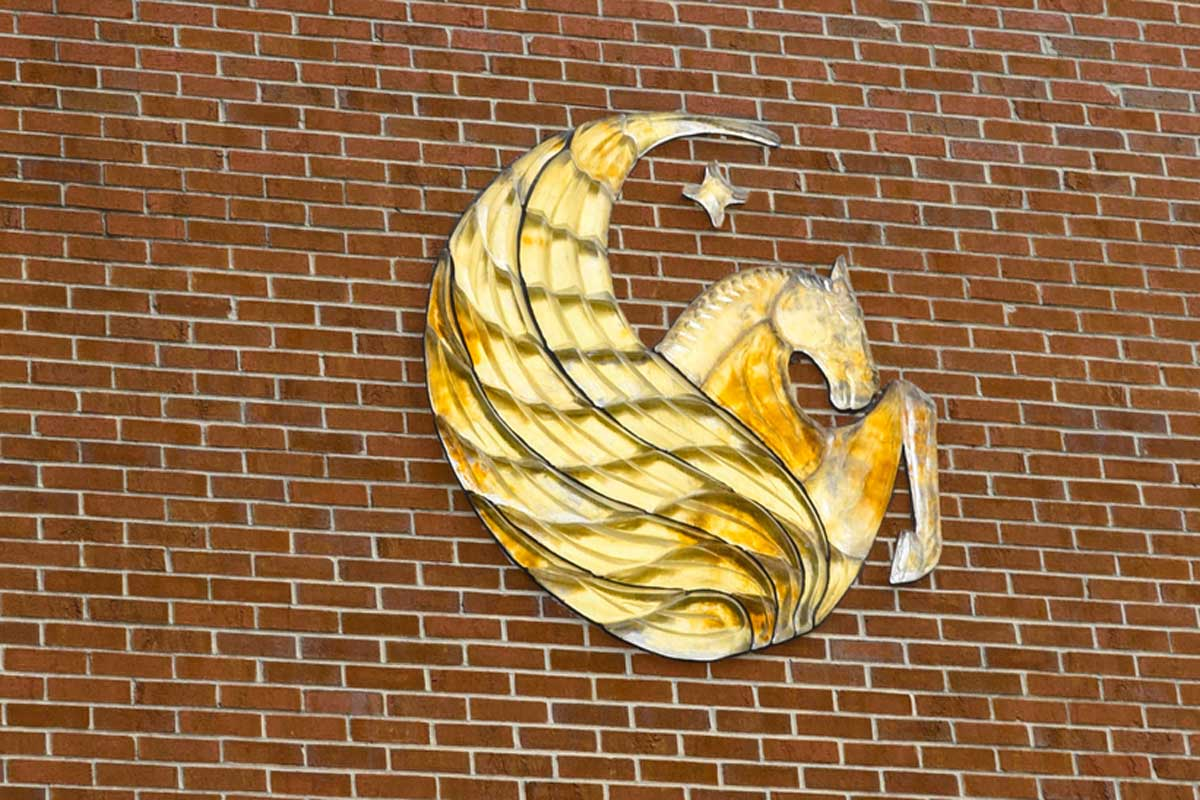 gold Pegasus on brick