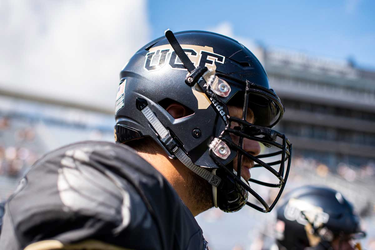 black football helmet with gold outline of Florida