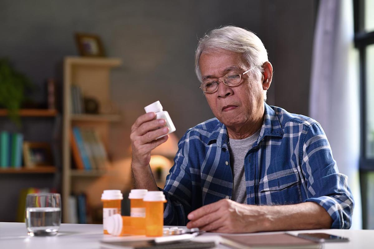 Senior man with his medicine bottles