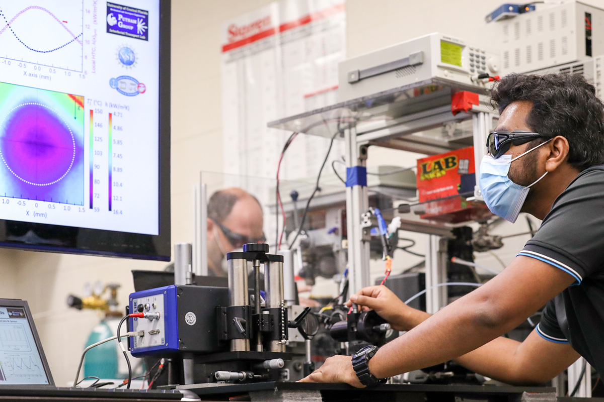 UCF researchers working on a cooling system for electronics