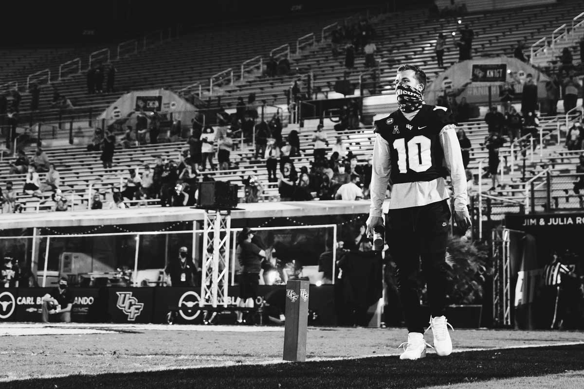 McKenzie Milton in #10 uniform looks out at field at the Bounce House
