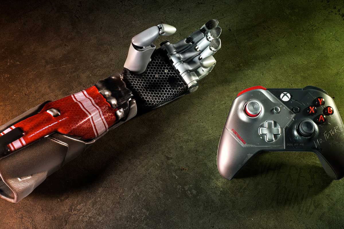 Red and silver bionic arm next to Xbox controller