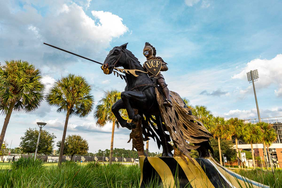 Charging Knight statue in front of the Bounce House wears a face mask