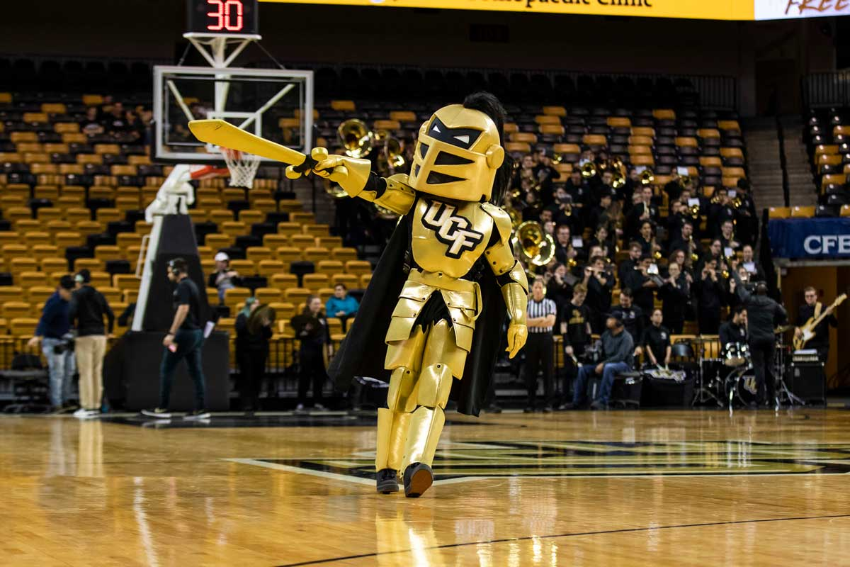Knightro points his sword on basketball court