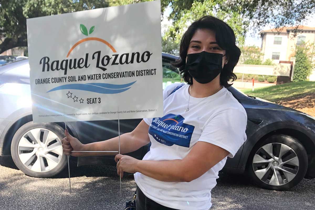 Raquel Lozano holds campaign sign