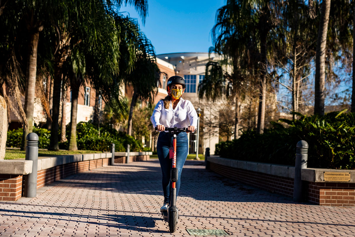 Student rides Spin Scooter on Memory Mall