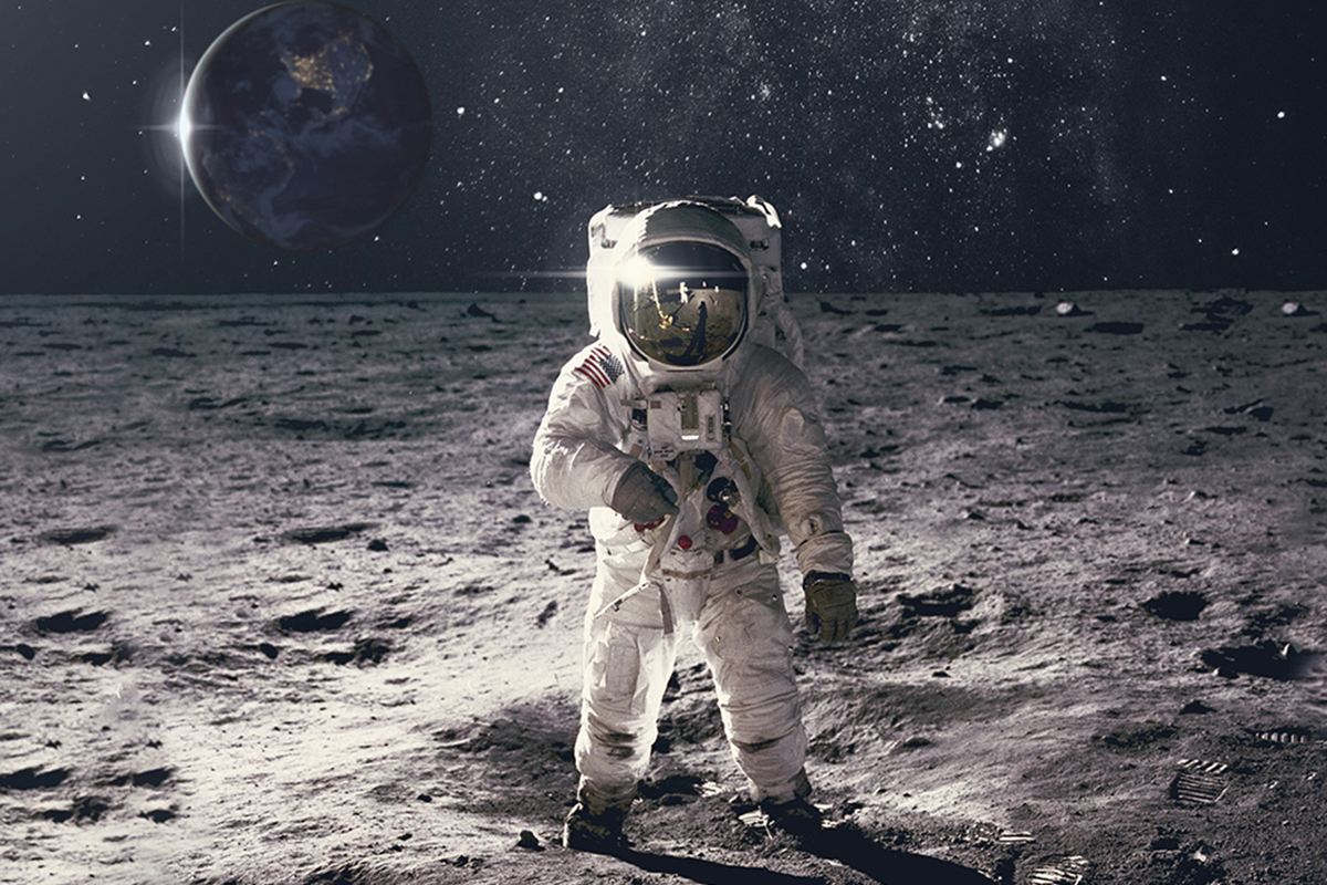 Astronaut on the moon looking at camera with Earth in background
