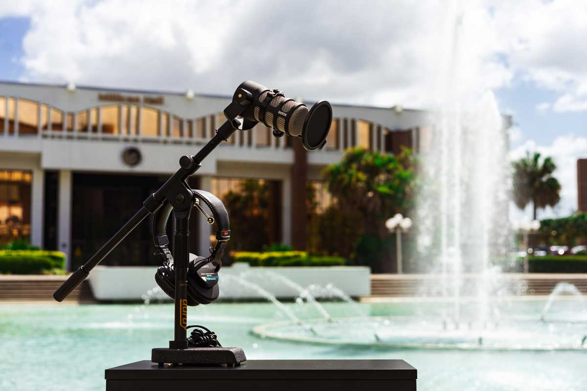 microphone on stand in front of Reflecting Pond