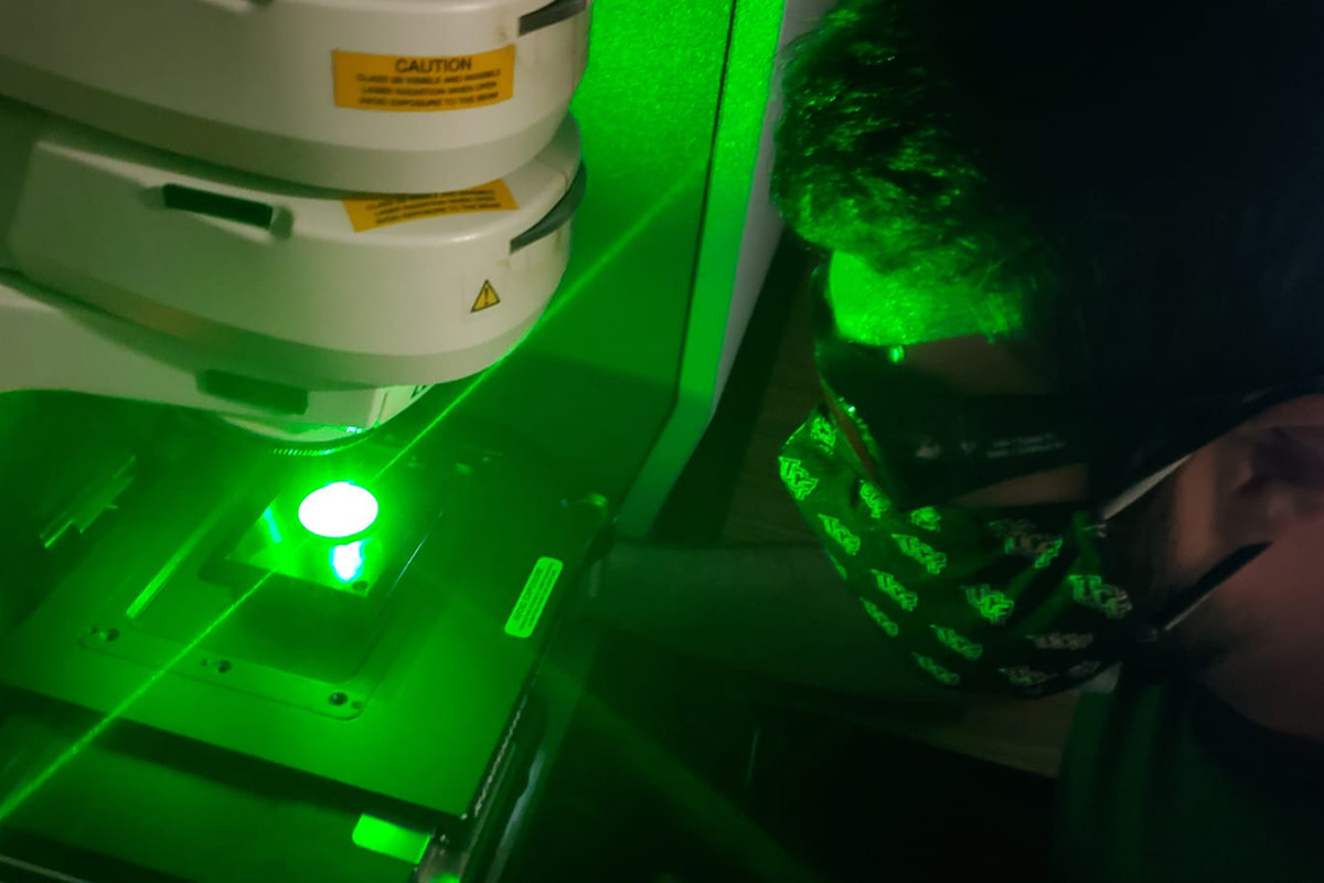 man doing laser research