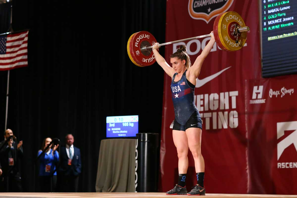 Mattie Rogers during competition, lifts weights and barbell overhead