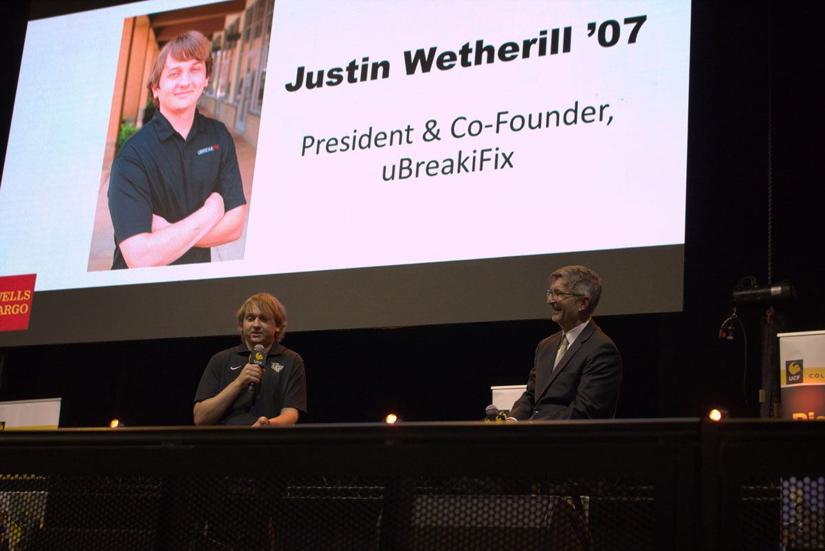 College of Business Dean Paul Jarley interviews UCF alum Justin Wetherill on stage