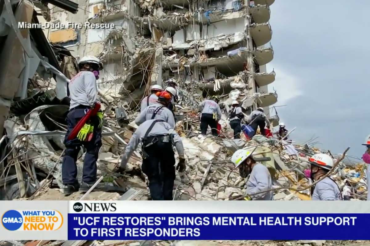 First responders stand on piles of rubble at Miami condo collapse site