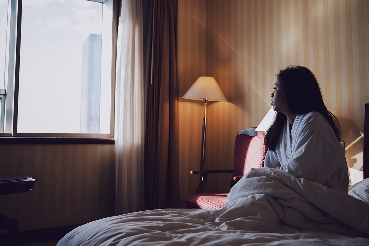 a person who is not feeling well is alone in a room