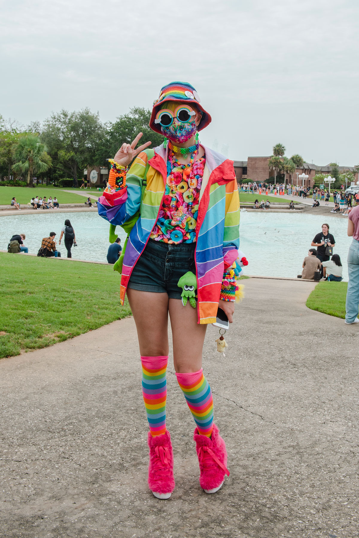 UCF student decked out in rainbow gear from head to toe near Reflecting Pond