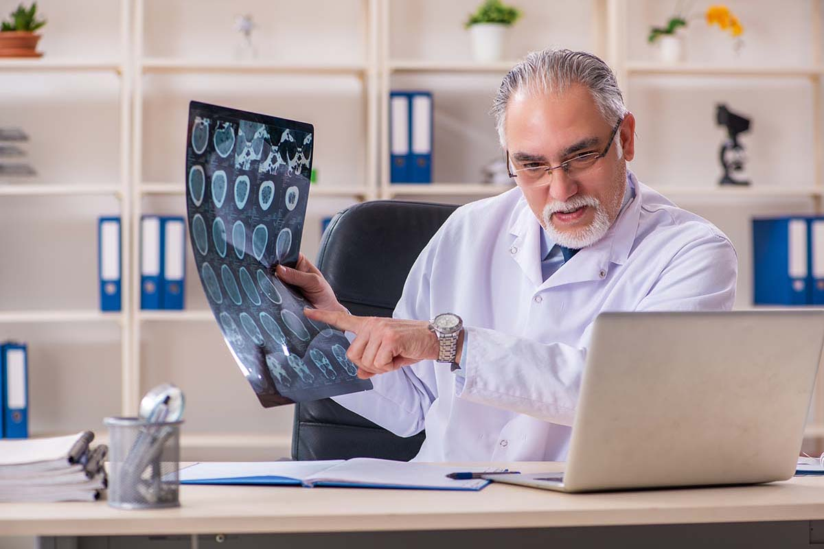 a doctor talking about x-rays to someone through a computer