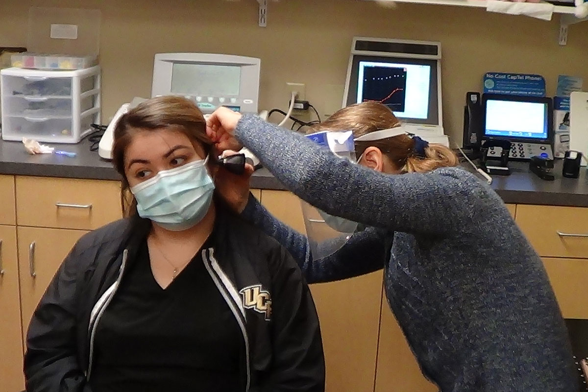 Selena Lopez gets her hearing checked by UCF faculty member