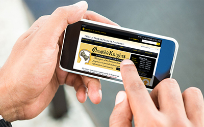 Hands browsing a website on a mobile phone