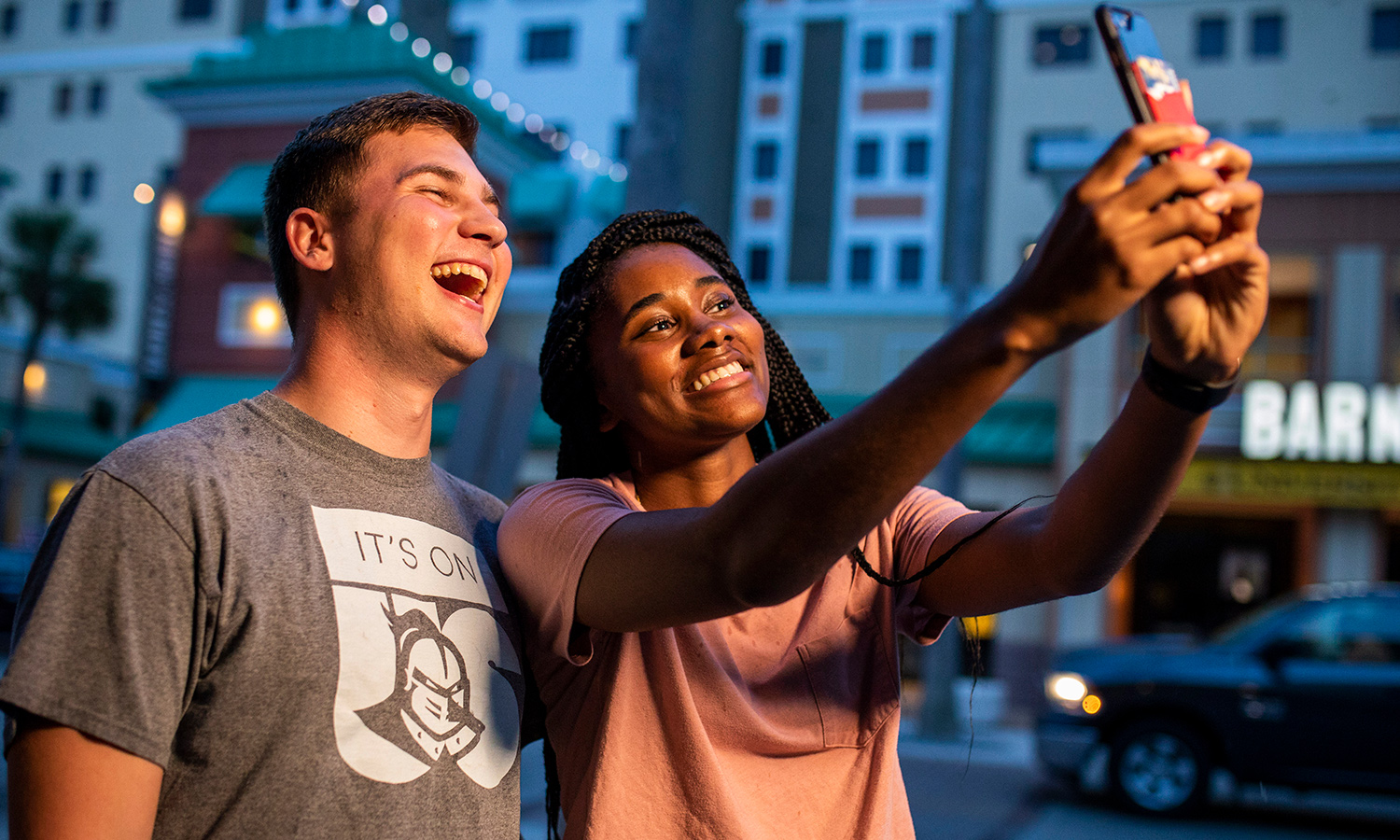 Students taking selfies to post on UCF Social channels.