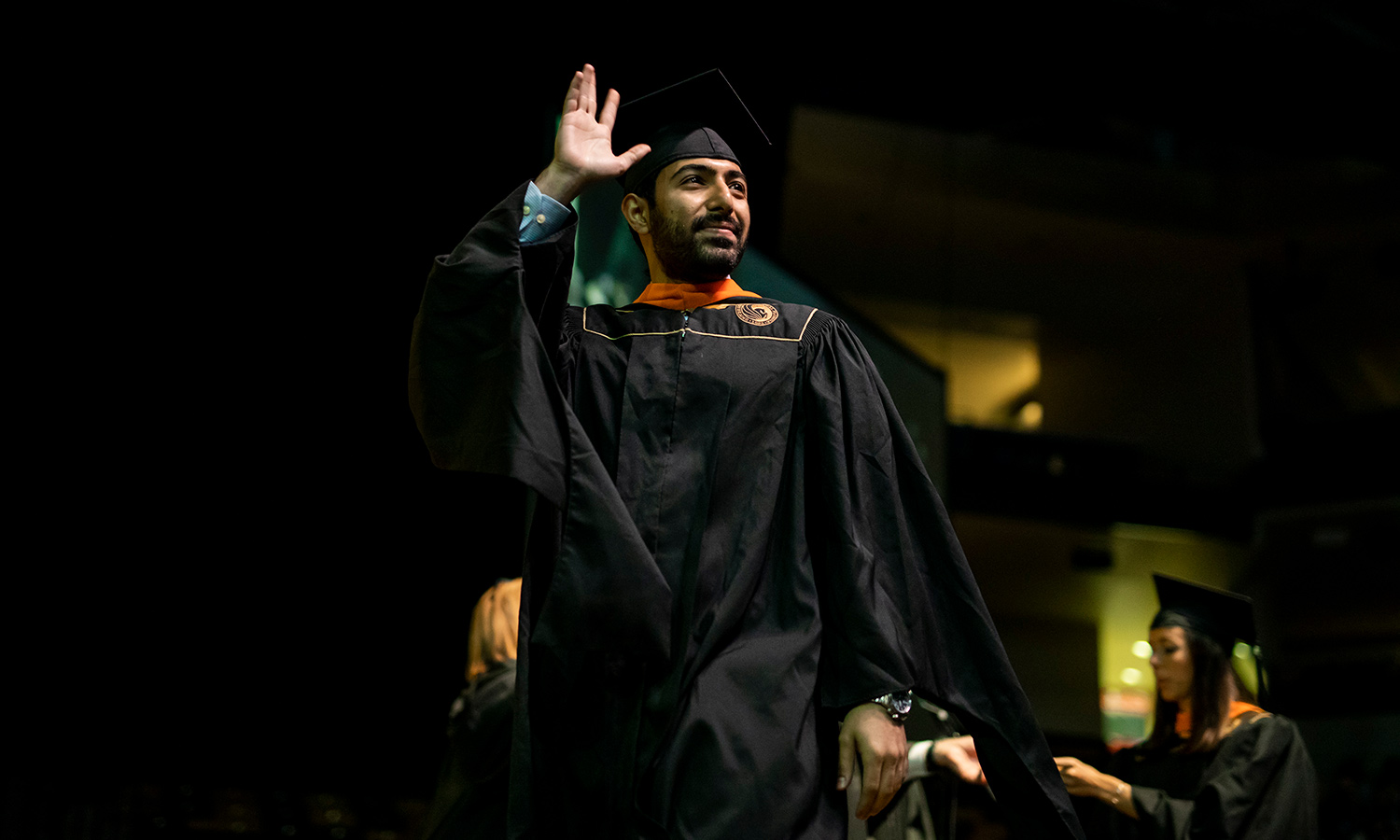 Successful student crosses the stage at graduation.