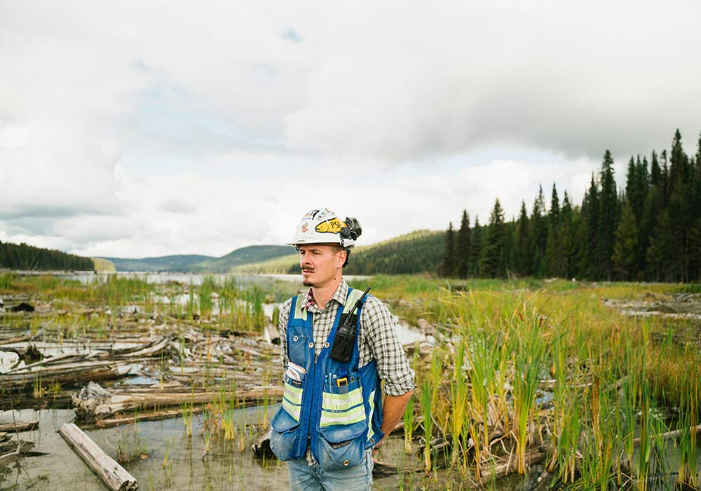 Environmental Engineer stands in a swamp.