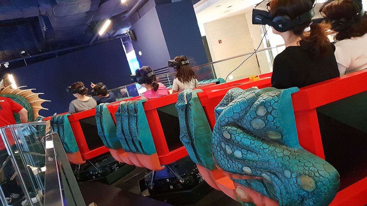 People wearing VR headsets on the Lotte Monster VR ride