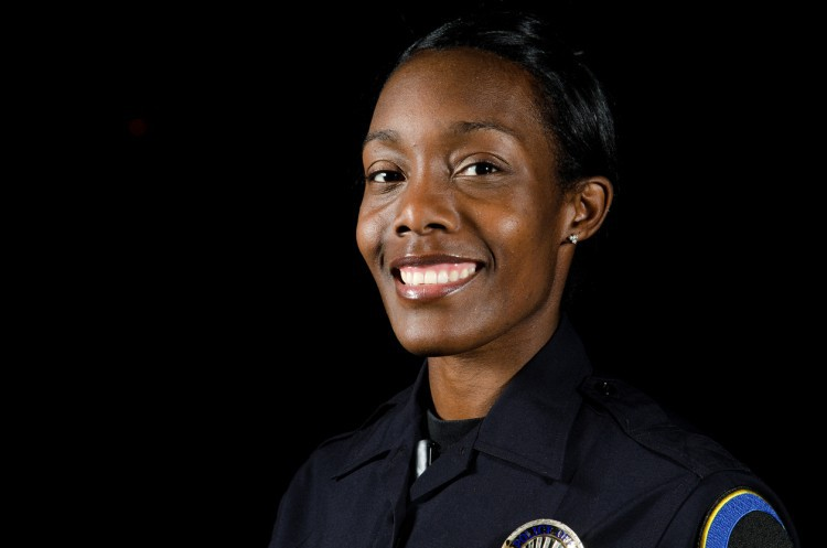 A smiling correctional officer.
