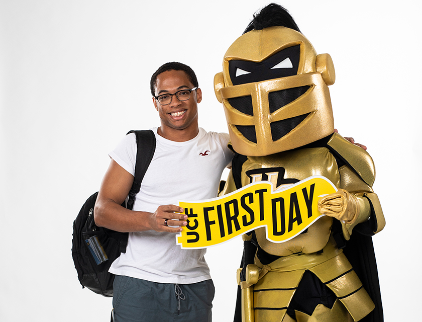 Man and Knightro excited about their first day at UCF.