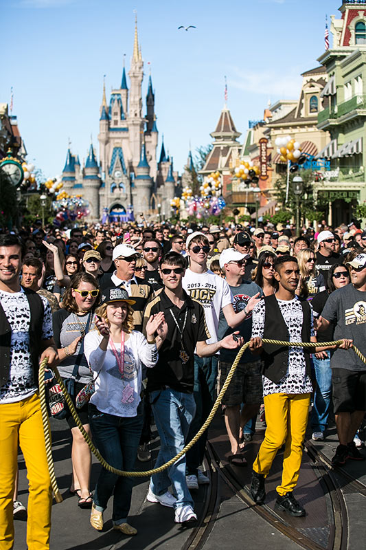 UCF Fans follow the parade at Magic Kingdom