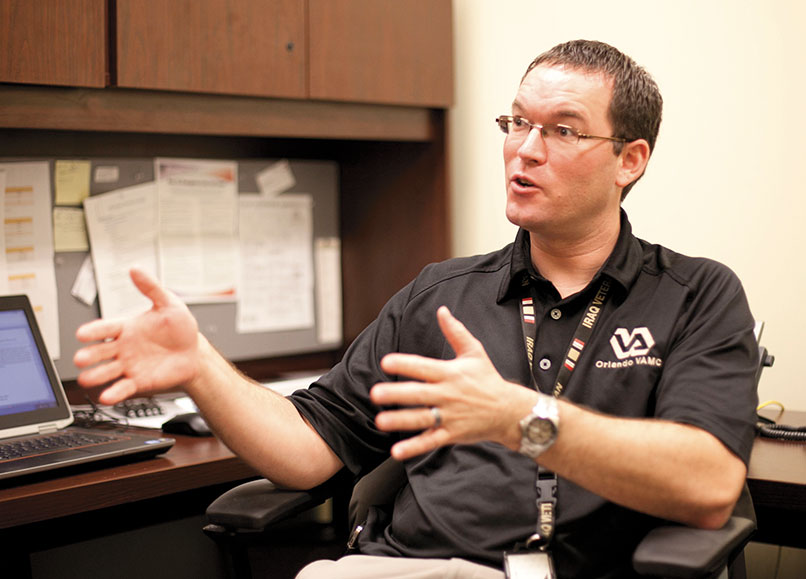 U.S. Department of Veterans Affairs psychologist Brian Batien counsels student veterans at UCF.