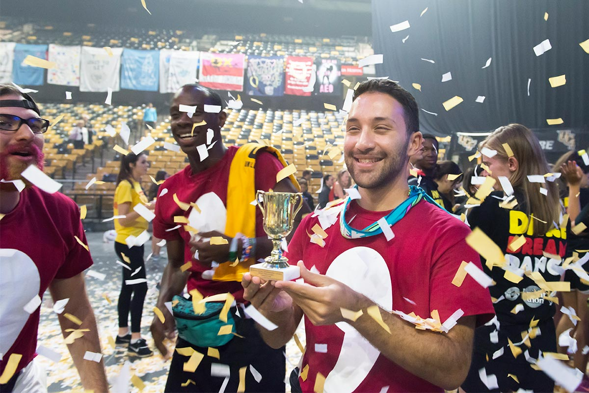 Volunteer with Trophy in Confetti