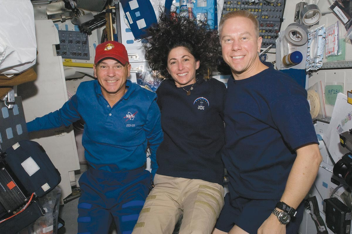 Stott and mission specialist Tim Kopra pose for a photo on Discovery while docked at the ISS