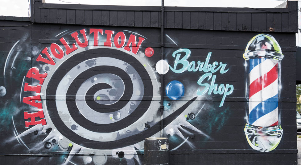 Mural on side of a barber shop