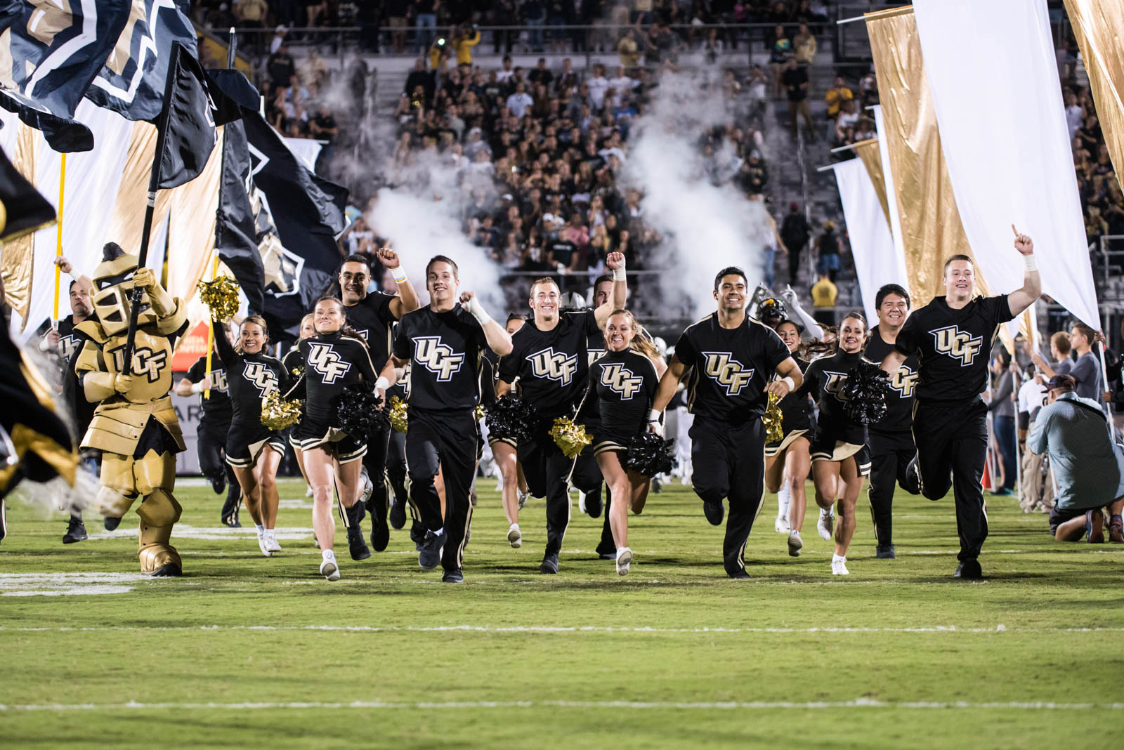 ucf-best-of-photos-cheerleaders-charge-the-field