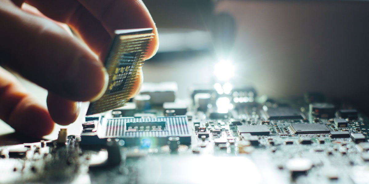 Hand placing micro processor onto a motherboard