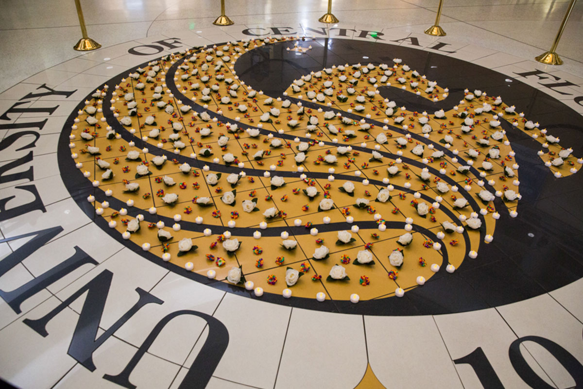 The giant Pegasus seal on the floor of the Student Union was filled in with white tea candles and tiny rainbow roses.