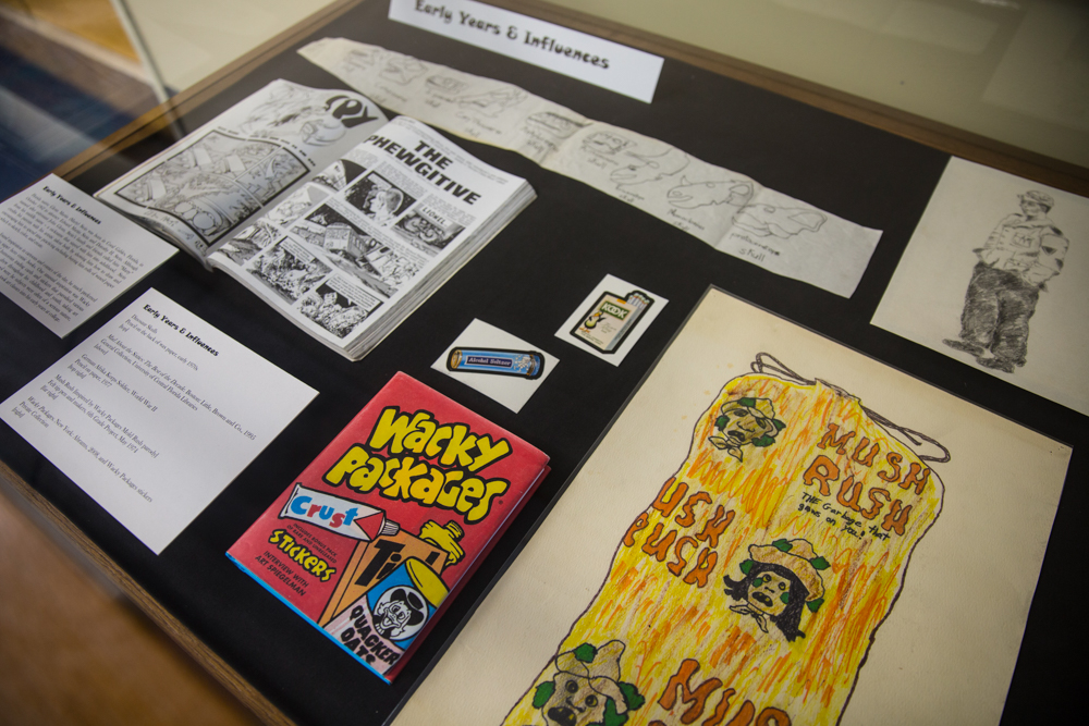 "<em>Recollections of a Cartoonist: The Glenn ""Marty"" Stein Collection of Cartoon Art, 1955–2013 </em>is currently on display in the Special Collections and University Archives' exhibit area located on the fifth floor of the John C. Hitt Library. The exhibit was curated from sketches, political cartoons, comics and other items created by Stein for three Orlando-based publications — the <em>Orlando Business Journal</em>, <em>Apopka Chief</em> and <em>La Prensa — </em>as well as early works and influences that helped him to develop his style."