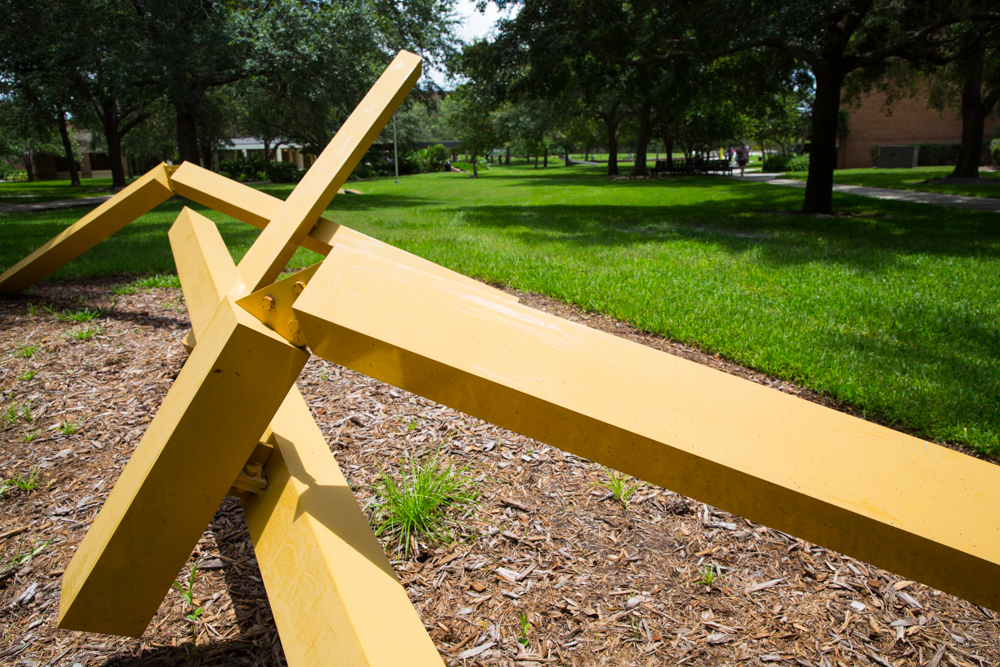 "On the grounds between Colbourn Hall and the Education Complex sits the vibrant yellow geometric <em>Sun Target 1</em>. The large-scale aluminum piece created by John Henry changes shape as viewers walk past it and is an exercise in minimalism and abstraction. ""John Henry has an international reputation and <em>Sun Target 1</em> is a fine example of some of the world-class art on campus,"" Haran says."