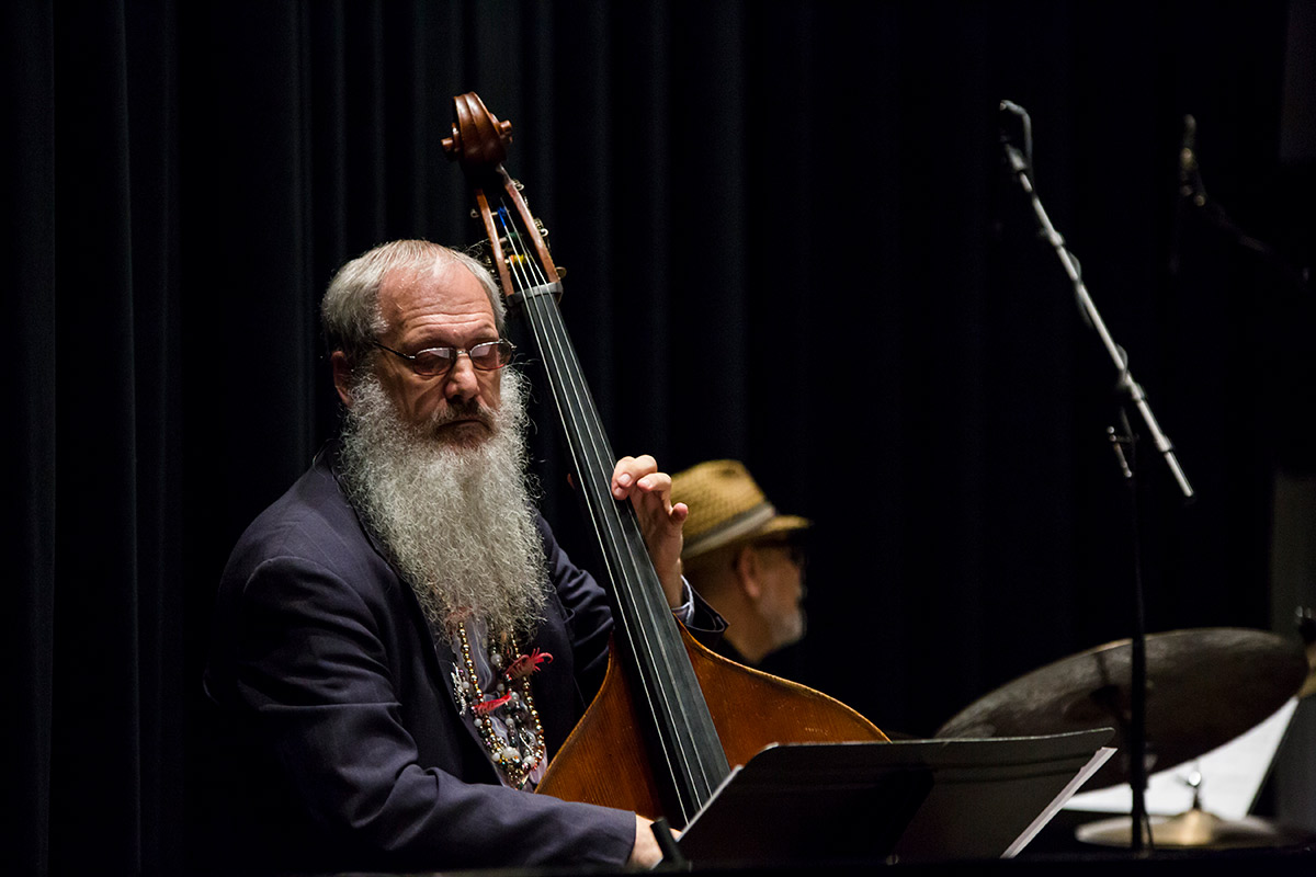 UCF Instructor Richard Drexler plays an upright bass on stage.
