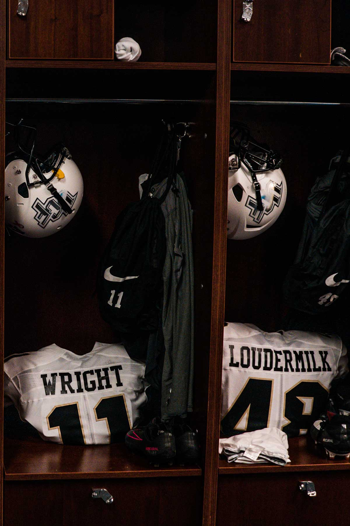 two lockers with white jersey and white helmets