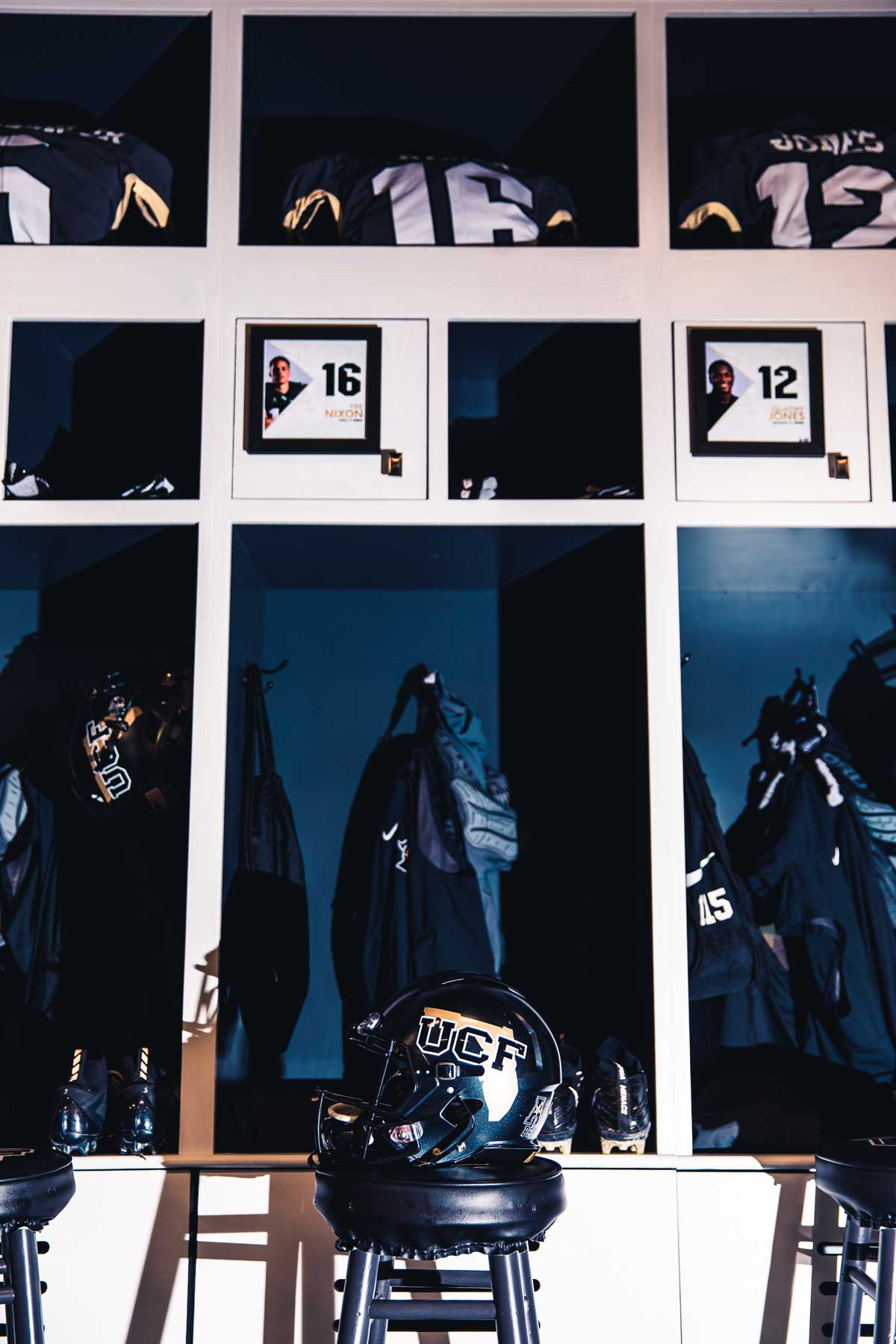 rows of three lockers with a black UCF helmet with the outline of the state of Florida on the side