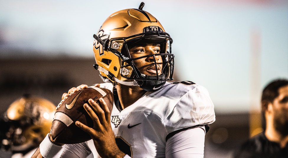 ucf quarterback Darriel Mack Jr. looks to throw the football during the game against east carolina