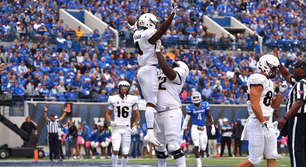 ucf offensive lineman jordan johnson celebrates with ucf  running back taj mcgowan during memphis game
