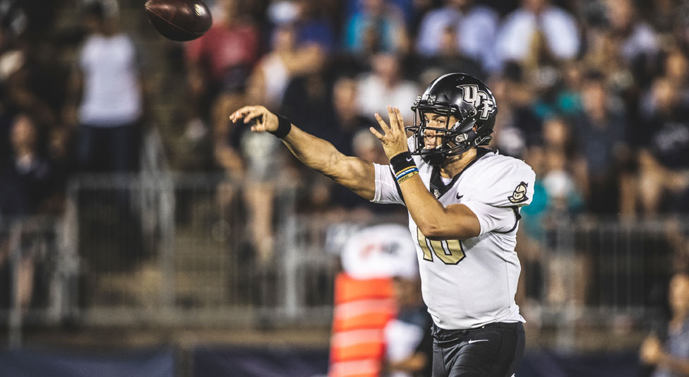 ucf quarterback McKenzie Milton throws the football during a game