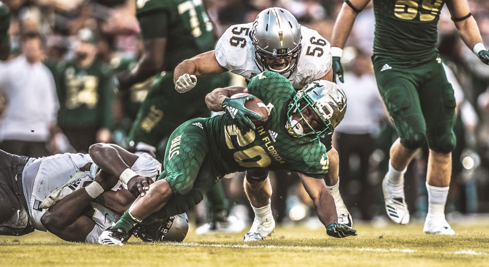 ucf offensive linebacker pat jasinski tackles usf player with football