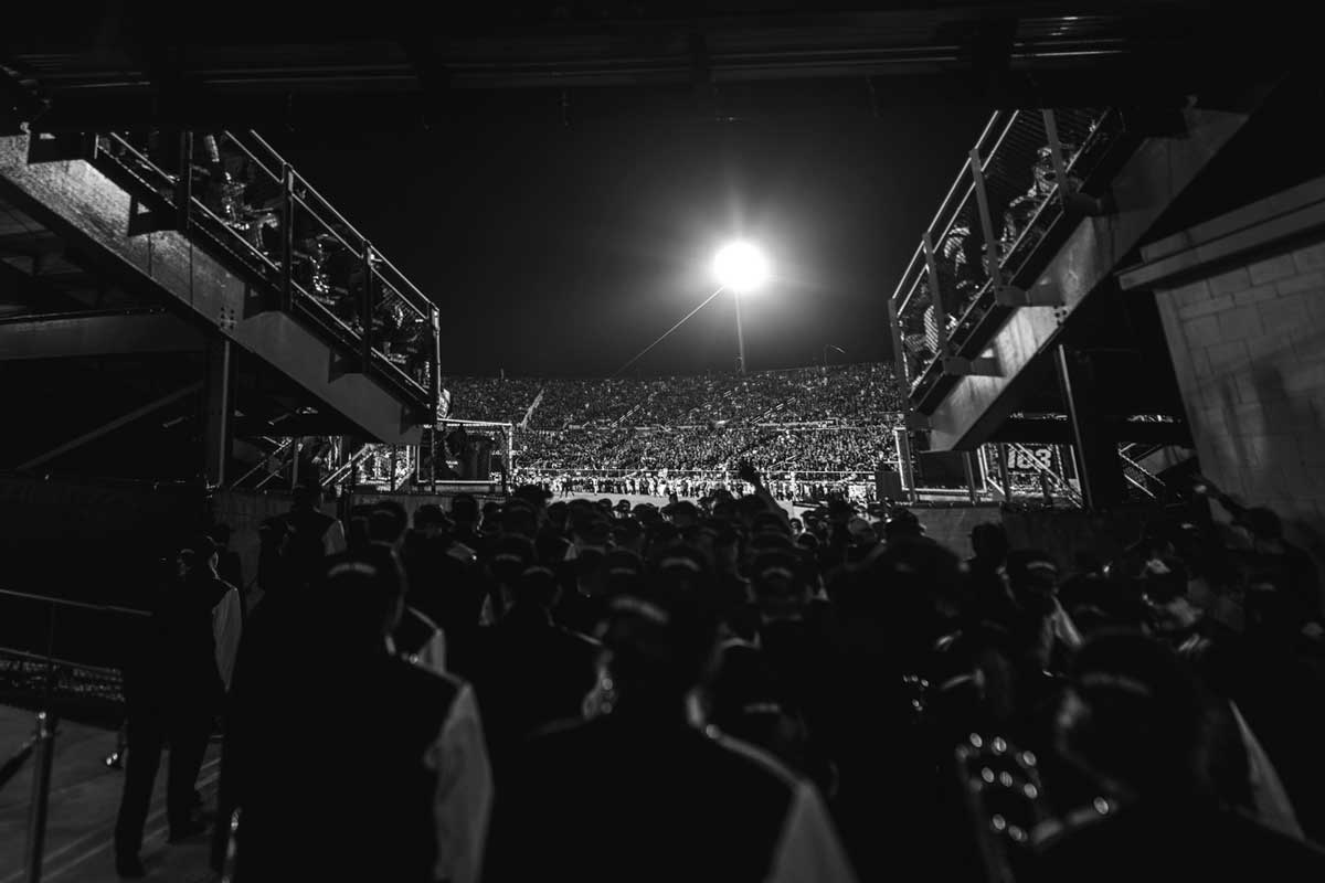 black and white of band entering football field